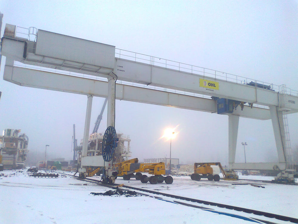 <br>Gantry crane with several 15t hoists for OHL in Poland.